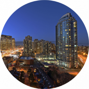 City buildings in North York, Canada, at nighttime, with city lights dotted throughout.